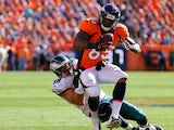 Virgil Green #85 of the Denver Broncos is tackles by Connor Barwin #98 of the Philadelphia Eagles after making a reception during the second quarter at Sports Authority Field Field at Mile High on September 29, 2013