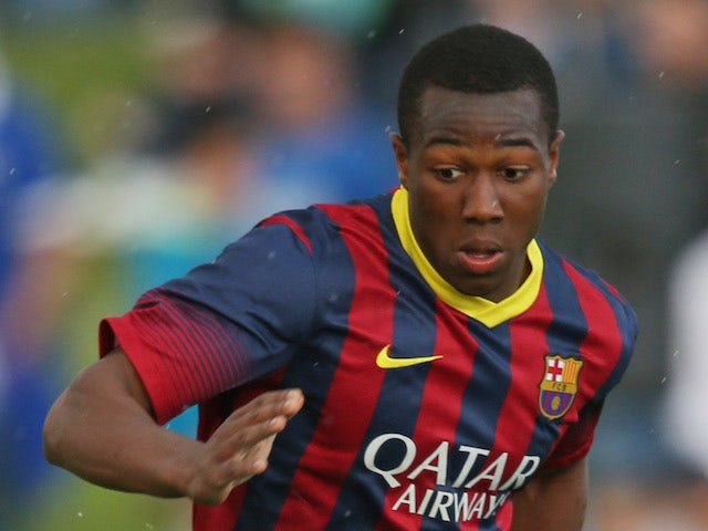Adama Traore of FC Barcelona during the UEFA Youth League Semi Final match between Schalke 04 and FC Barcelona at Colovray Stadion on April 11, 2014
