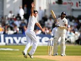 Alastair Cook celebrates taking a wicket on day five of first Test between England and India at Trent Bridge on July 13, 2014