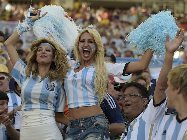 Argentina's fans cheer prior to the 2014 FIFA World Cup final football match between Germany and Argentina at the Maracana Stadium in Rio de Janeiro, Brazil, on July 13, 2014