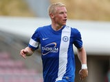 Craig Alcock of Peterborough United in action during the Pre-Season Friendly match between Northampton Town and Peterborough United at Sixfields Stadium on July 20, 2013
