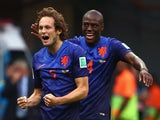 Daley Blind of the Netherlands (L) celebrates scoring his team's second goal against Brazil with teammate Bruno Martins Indi during the 2014 FIFA World Cup 3rd Place Playoff on July 12, 2014