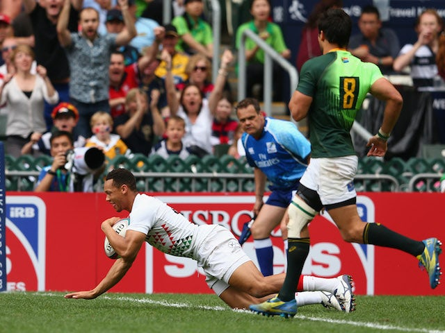 Dan Norton of England scores a try during the Cup quarter-final match between England and South Africa during the 2014 Hong Kong Sevens at Hong Kong International Stadium on March 30, 2014