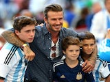 Former England international David Beckham and sons Brooklyn Beckham (L), Cruz Beckham (2nd R) and Romeo Beckham (R) prior to the 2014 FIFA World Cup final on July 13, 2014