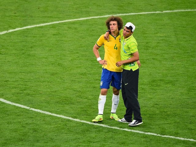 Thiago Silva consoles fellow Brazilian defender David Luiz after the semi-final World Cup exit to Germany on July 8, 2014