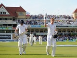 Joe Root and James Anderson of England leave the field at stumps on day three of 1st Investec Test match between England and India at Trent Bridge on July 11, 2014
