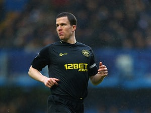 Gary Caldwell of Wigan Athletic looks on during the Barclay's Premier League match between Chelsea and Wigan Athletic at Stamford Bridge on February 9, 2013