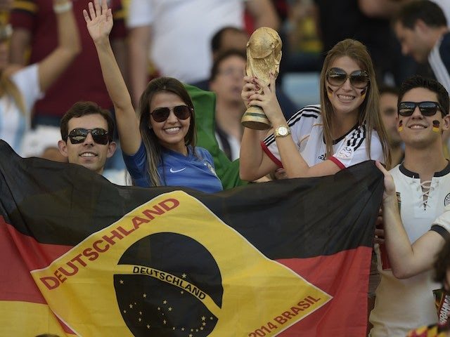 Germany's fans cheer prior to the 2014 FIFA World Cup final football match between Germany and Argentina at the Maracana Stadium in Rio de Janeiro, Brazil, on July 13, 2014