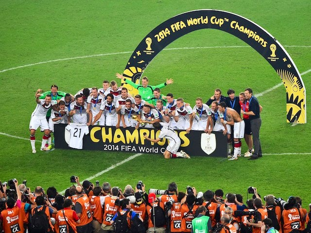 Germany's players celebrate after winning the final football match between Germany and Argentina for the FIFA World Cup at The Maracana Stadium in Rio de Janeiro on July 13, 2014