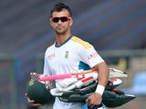 South African cricketer Jean-Paul Duminy walks to the field during a practice session at the Pallekele International Cricket Stadium in Pallekele on July 8, 2014