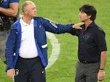 Germany's coach Joachim Loew (R) commiserates with Brazil's coach Luiz Felipe Scolari after Brazil lost the semi-final football match on July 8, 2014