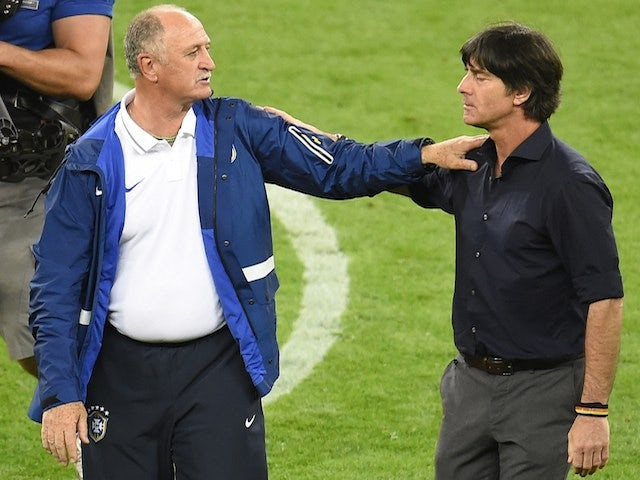 Germany's coach Joachim Loew (R) commiserates with Brazil's coach Luiz Felipe Scolari after Brazil lost the semi-final football match on July 8, 2014