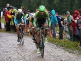 Lars Boom of The Netherlands and the Belkin Pro Cycling Team enters the final sections of cobbles en route to victory in the fifth stage of the 2014 Tour de France on July 9, 2014