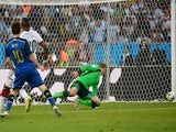 Argentina's forward and captain Lionel Messi (front) misses a shot on goal during the first half of the 2014 FIFA World Cup final football match on July 13, 2014
