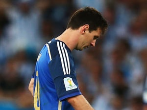 Lionel Messi admits 'pain' after defeat