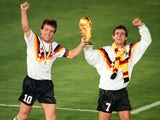Germany captain Lothar Matthaus lifts the World Cup trophy on July 08, 1990.