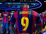 A shirt of new FC Barcelona player Luis Suarez as seen on display at the FC Barcelona official store on July 12, 2014 in Barcelona, Spain