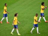 Luiz Gustavo, David Luiz, Fernandinho and Dante of Brazil look dejected after a goal during the 2014 FIFA World Cup Brazil Semi Final match on July 8, 2014