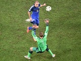 Germany's goalkeeper Manuel Neuer (FRONT) prepares to make a save from Argentina's forward Rodrigo Palacio during the final football match o