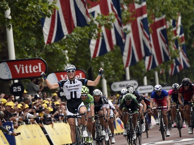 Giant-Shimano rider Marcel Kittel of Germany crosses the line in first place at the end of stage three of the 2014 Tour de France in London on July 7, 2014