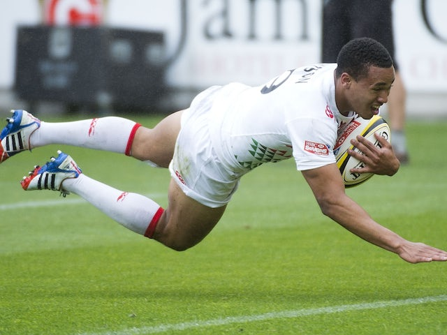 Marcus Watson of England scores a try in their Cup Quarter Final match against Samoa during round 5 of the IRB Rugby Sevens in Wellington on February 8, 2014