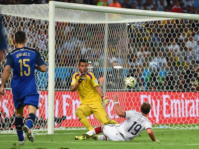 Mario Goetze of Germany scores his team's first goal past Sergio Romero of Argentina in extra time during the 2014 FIFA World Cup inal on July 13, 2014