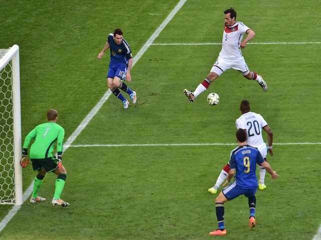 Germany's defender Mats Hummels (R) blocks a ball to Argentina's forward and captain Lionel Messi (R) during the 2014 FIFA World Cup final on July 13, 2014