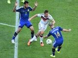 Germany's forward Miroslav Klose (C) tackles Argentina's midfielder Javier Mascherano (R) as Argentina's defender Ezequiel Garay looks on during the final football match on July 13, 2014