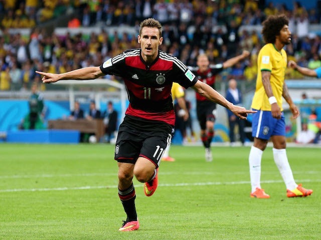 Miroslav Klose of Germany celebrates scoring his team's second goal during the 2014 FIFA World Cup semi final against Brazil on July 8, 2014