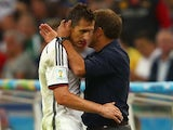 Assistant coach Hansi Flick hugs Miroslav Klose of Germany as he exits the game during the 2014 FIFA World Cup Brazil Final match on July 13, 2014