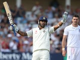 ndia's Murali Vijay celebrates after reaching his century as England bowler James Anderson (R) looks on during play on day 1 of the first cricket Test match between England and India at Trent Bridge in Nottingham, central England, on July 9, 2014