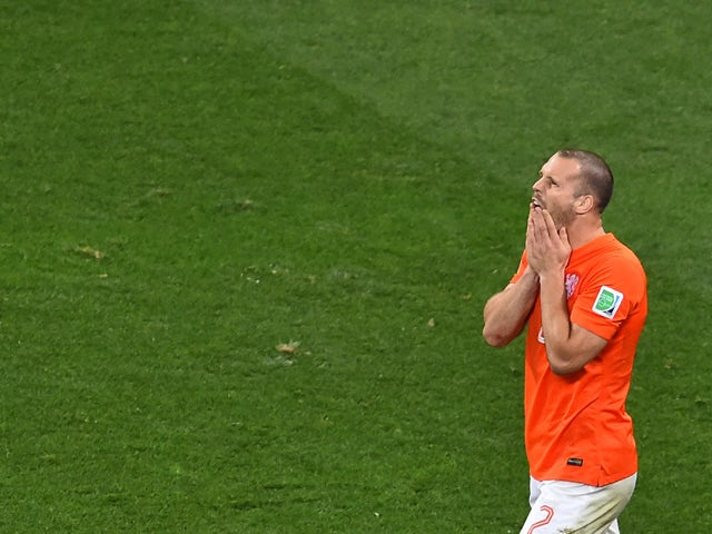 Netherlands' defender Ron Vlaar reacts after missing during penalty shoot-outs following extra time during the semi-final football match between Netherlands and Argentina of the FIFA World Cup at The Corinthians Arena in Sao Paulo on July 9, 2014