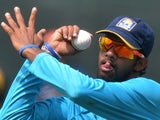 Sri Lankan bowler Sachithra Senanayake delivers a ball during a practice session at the R. Premadasa International Cricket Stadium in Colombo on July 5, 2014