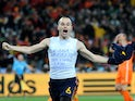 Spain's midfielder Andres Iniesta celebrates after scoring during extra-time in the 2010 World Cup football final Netherlands vs. Spain on July 11, 2010