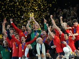 Spain's national football team players celebrate with the trophy during the award ceremony following the 2010 World Cup football final Netherlands vs. Spain on July 11, 2010