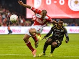 Standard's Tal Ben Haim vies with Lokeren's Ayanda Patosi during the Belgian Jupiler Pro League football match between Standard de Liege and Lokeren, on April 17, 2014