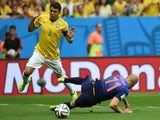 Brazil's defender and captain Thiago Silva (L) reacts after fouling Netherlands' forward Arjen Robben in the penalty area during the third place play-off football match  on July 12, 2014