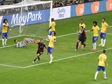 Germany's forward Thomas Mueller (3L) celebrates after scoring during the semi-final football match between Brazil and Germany at The Mineirao Stadium on July 8, 2014