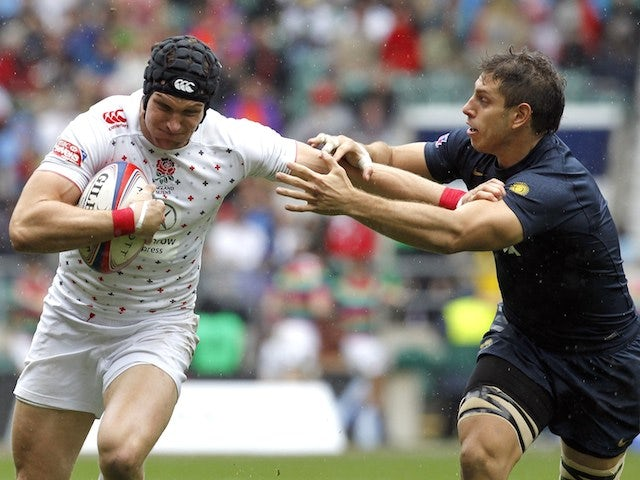 England's Tom Powell (L) vies with Argentina's Nicolas Coronel during the Rugby Union England Sevens Cup at Twickenham Stadium, southwest London, on May 10, 2014
