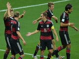 Germany's players celebrate after midfielder Toni Kroos scored his team's third goal during the semi-final football match against Brazil on July 8, 2014