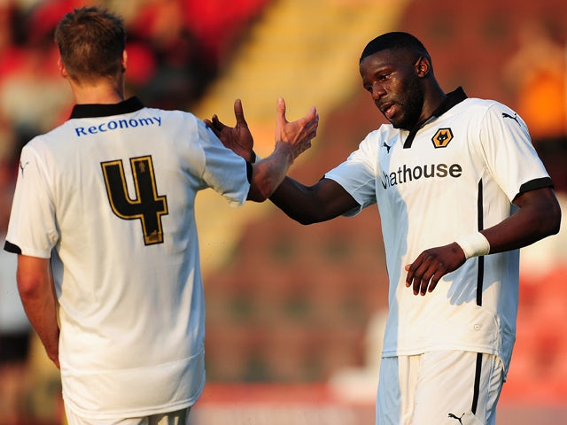Bakary Sako of Wolverhampton Wanderers celebrates scoring his side's first goal with David Edwards of Wolverhampton Wanderers during the Pre-Season Friendly match between Cheltenham Town and Wolverhampton Wanderers at The Abbey Business Stadium on July 11