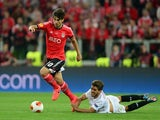 Andre Gomes of Benfica evades the challenge from Daniel Carrico of Sevilla during the UEFA Europa League Final match between Sevilla FC and SL Benfica at Juventus Stadium on May 14, 2014