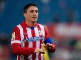 Cristian Rodriguez of Atletico de Madrid jokes with Atletico de Madrid fans playing Uruguayan Kettledrums after the Copa del Rey Round of 32 second leg match between Club Atletico de Madrid and Sant Andreu at Vivente Calderon Stadium on December 18, 2013