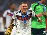Germany's Bastian Schweinsteiger celebrates with the World Cup trophy on July 13, 2014.