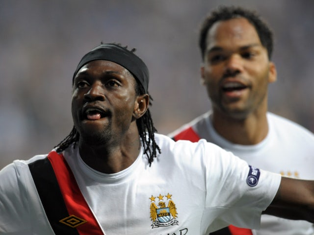 Emmanuel Adebayor of Manchester City reacts after scoring a goal against Lech Poznan during their UEFA Europa League football match on November 4, 2010