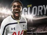 Emmanuel Adebayor models the Spurs 2014-15 home kit