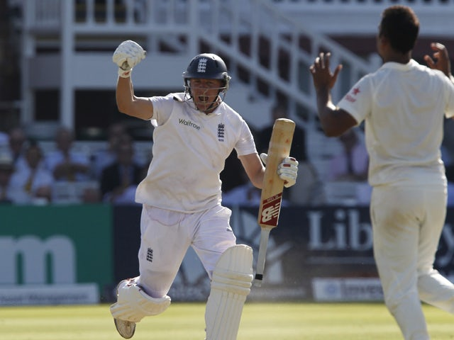 Englands Gary Ballance celebrates as he runs to reach a century not out during play on the second day of the second cricket Test match between England and India at Lord's cricket ground in London on July 18, 2014