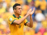 Jason Davidson of Australia acknowledges the fans after being defeated by Spain 3-0 during the 2014 FIFA World Cup Brazil Group B match between Australia and Spain at Arena da Baixada on June 23, 2014