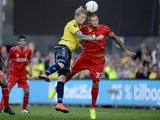 Simon Makienok of Brondby vies with Martin Skrtel of Liverpool on July 16, 2014