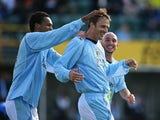 Dietemar Hamann of Manchester City celebrates with Jo Silva and Stephen Ireland after scoring the second goal during the UEFA Cup 1st Round 1st Leg Qualifying match between EB/Streymur and Manchester City at the Torsvollur Stadium on July 17, 2008